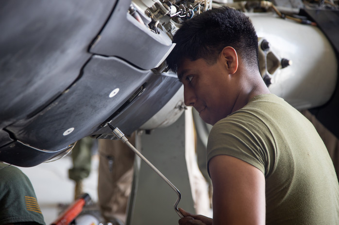 A Helicopter/Tiltrotor Mechanic MOS at work