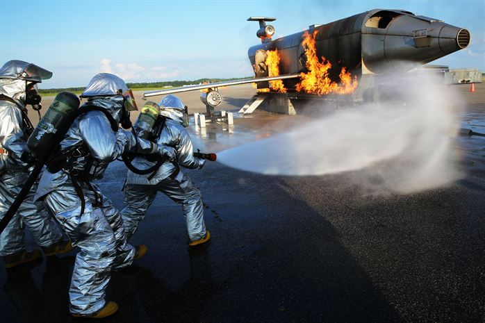 An Aircraft Rescue and Firefighting Specialist at work